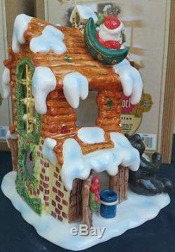 Grandeur Noel 4 Piece Illuminated Ceramic Holiday Village Church Cabin Santa