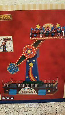 Lemax Christmas Village Carnival Ride The Shooting Star looks like Dept 56